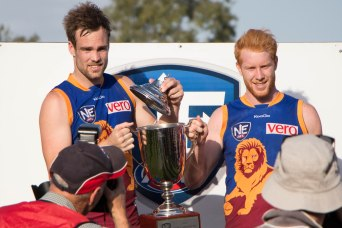 Brisbane Lions Reserves Co-Captains Aaron Cornelius & Todd Banfield receive the Northern Conference trophy (picture by Phil Harsant)