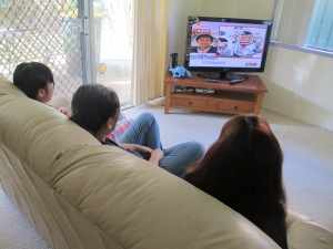 Chinese students in share house watch Chinese TV programme. Photo by Kan Jiang