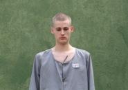 Matthew Miller pictured in prison attire, begins sentence in North Korea. Photo: Q13 Fox News