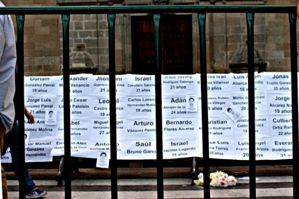 A protest in Mexico City where the names of the missing students are shown. Image by: Sapdiel Gómez Gutiérrez on Flickr