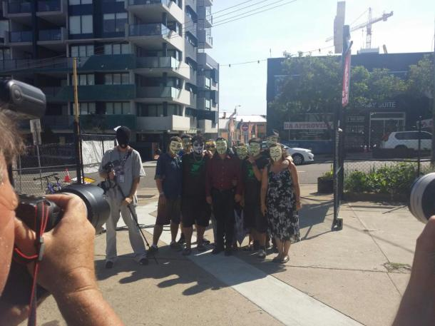 Anonymous protesters at  Wandering Cooks near Musgrave Park. Photo: Anonymous Affiliate Greg Johnson