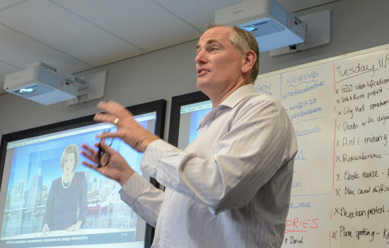 Dean Gould addresses journalism students in Griffith University's South Bank newsroom. Photo: Cory Wright.
