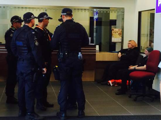 Two female protesters arrested at Police Head Quaters. One charged with possessing prohibited items. Both excluded. Photo: The Courier-Mail, Brittany Vonow