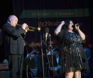 James Morrison and and vocalist Chrislyn Hamilton perform for a crowd at the Riverstage in Brisbane's CBD 7 November 2014. James Morrison directs the World According to Brass performance as part of the Queensland Music Festival's contribution to the G20 Cultural Celebrations. Picture: The Source News Janelsa Ouma