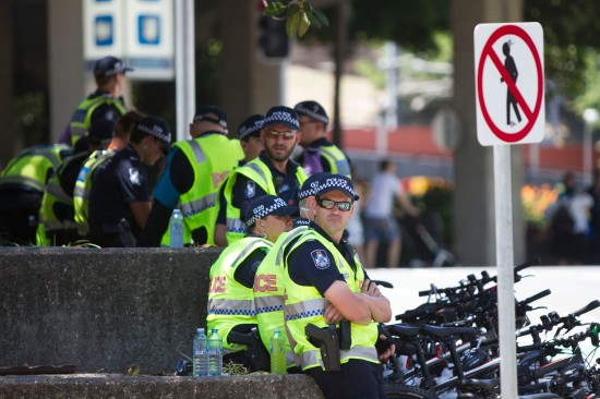 Police kept their eyes on all protesters at the People's March, November 15 2014. Photo: Dan Carson.