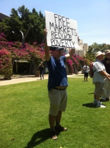 """""""Free the Market"""" protester taking a stand against trade barriers at South Bank gardens. NOVEMBER 15,  Photo: Inge Hansen"""