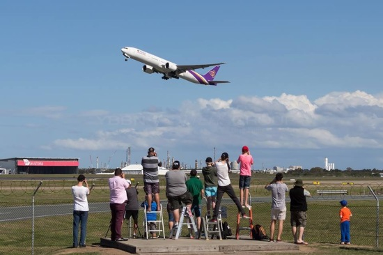 Plane spotters at the Brisbane Airport. Photo: Tim Hillier