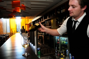 Bar manager, Matthew Fearnley, 25 pours a glass of wine at The Laneway November 5, 2014. The Laneway bar and restaurant will be a hotspot playing host to hundreds of local and international journalist over the G20 period in the CBD area. The Source News Janelsa Ouma.