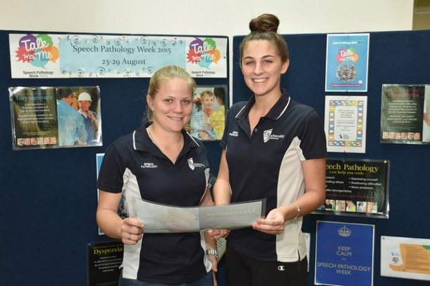 Third-year students Emily Tobin (left) and Mikaela Hayman with a Speech Pathology Week display at the Health Clinic at CQUniversity Rockhampton campus. Source: Peter Lawrence