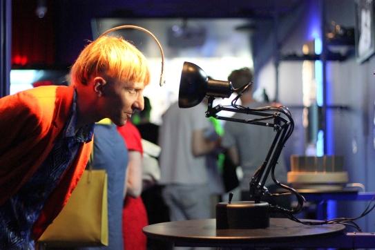 Cyborg activist Neil Harbisson with Pinokio, a robotic desk lamp. Source: QUT media.