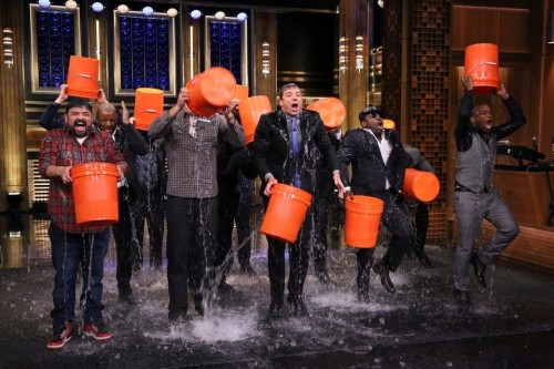 Jimmy Fallon taking the Ice Bucket Challenge on The Tonight Show with guests, Rob Riggle, Horatio Sanz, Steve Higgins, and The Roots, in August 2014. Source: thenational.ae