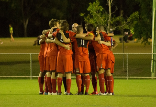 Redlands United Senior NPL (National Premier League) potential all-star players huddle before a game.