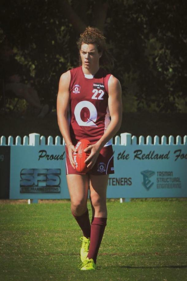 Wylie Buzza lines up a kick for Queensland's Youth AFL team. Source: Facebook.