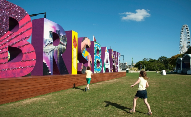 Olivia McLachlan, 5, plays a game of tag with her brother Connor McLachlan, 7, infornt of the 'Brisbane' sign in South Bank November 5, 2014. The 'Brisbane' sign is part of the G20 cultural celebrations inwhich each letter was decorated by a selcted community group in Brisbane. The Source News, Janelsa Ouma