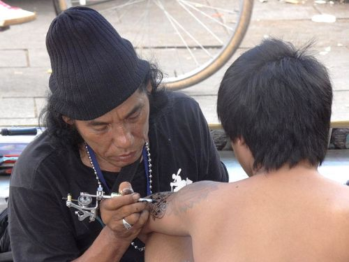 Man getting tattood in Indonesia Source: Wikimedia
