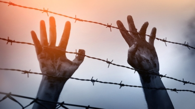 bigstock-Refugee-men-and-fence-Refugee-116790290.jpg