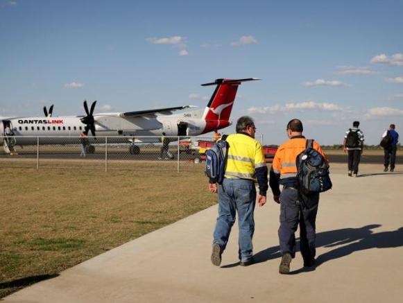 flyinflyout workers boarding plane