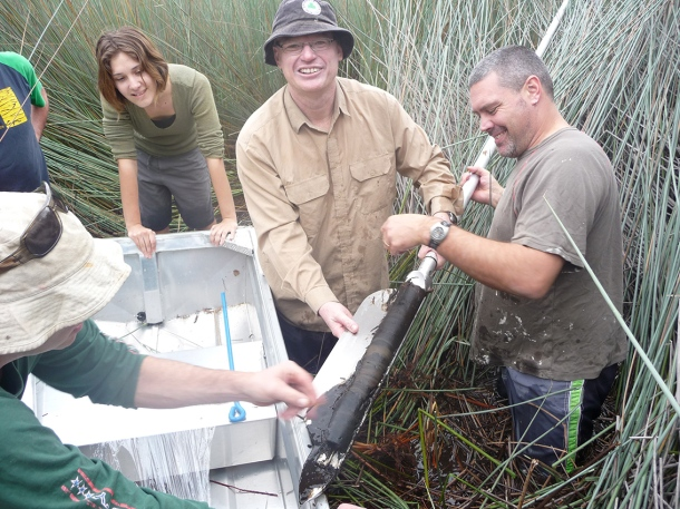 From left John tibby holding the core, lydia mckenzie, jonathon marshall and cameron barr coring at Duck Lagoon