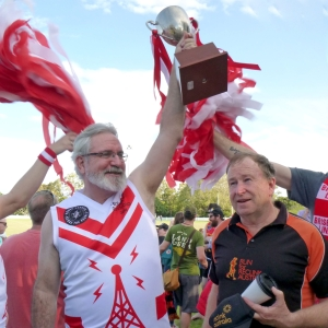 Greens Senator Andrew Bartlett with Reclink founder Peter Cullen holding up the 2018 cup