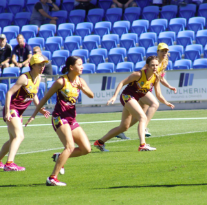 The women's Brisbane Broncos touch team defending their line. Photo provided by James Courtney.