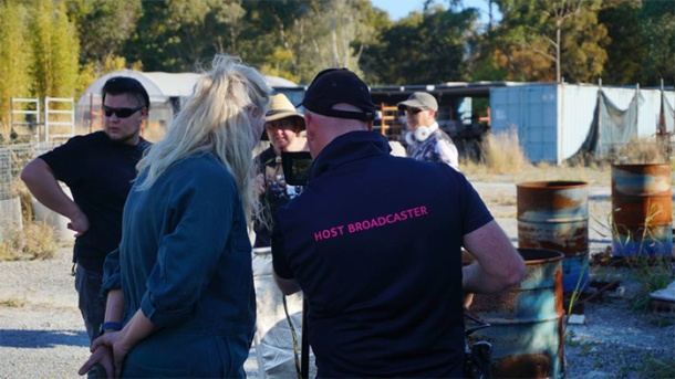 Vicky Wanless and Justin Hartnell review footage during a break in filming