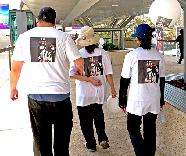 Demonstrators wearing Tran Huynh Duy Thun t-shirts