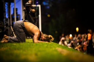 Xavier Rudd praying to the earth as part of his Woodford show. Picture Dylan Crawford @seewhatdsees
