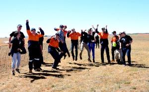 Students celebrate kit built plane's test flight