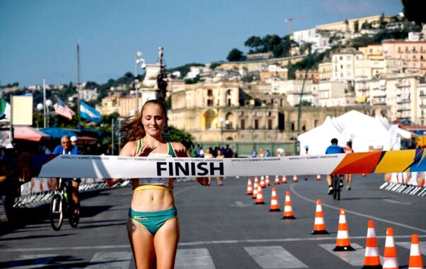Katie Hayward crossing the finishing line at the World University Games