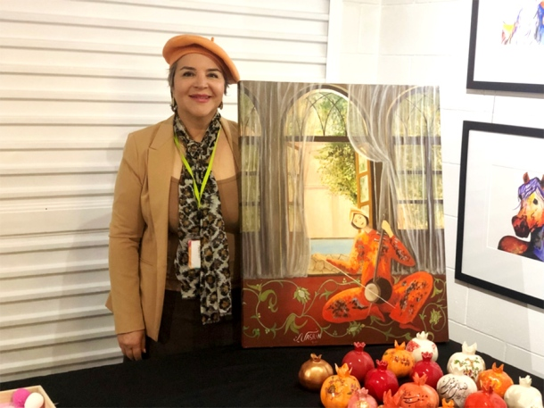 Nasrin Vizari with her pomegranate art