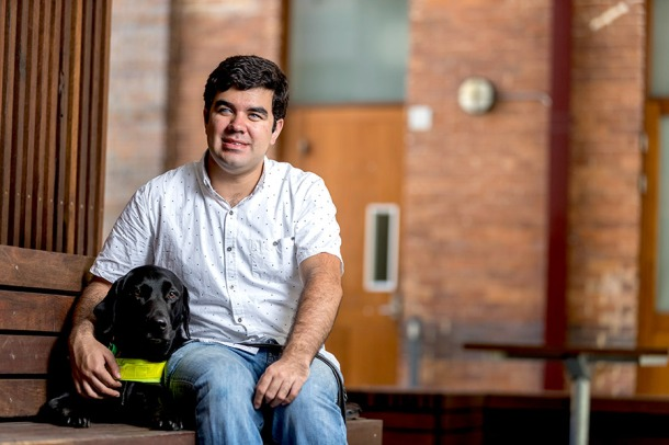 Santiago and his guide dog Lachy