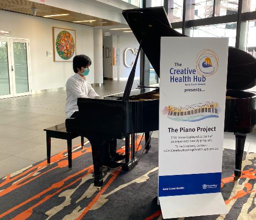 Piano club volunteer Oscar Wong